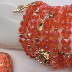 NWOT 7 Orange Glass Gold Tone Stack Charm Bracelet